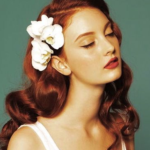 large-white-flower-in-red-hair