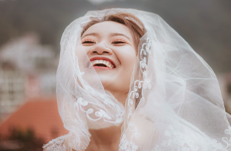 Wedding Makeup - Joyful Bride With Veil