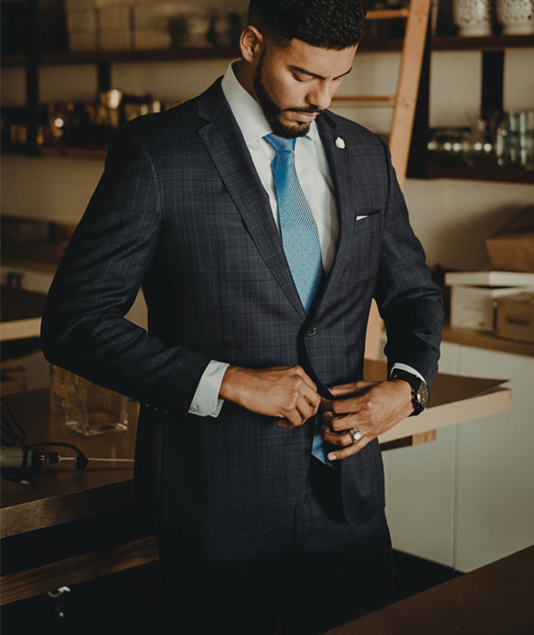 Wedding Guest Questions - Man Buttoning Up Suit