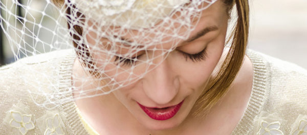 Woman Wearing White Birdcage Veil