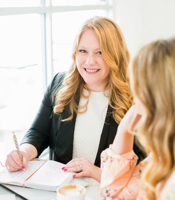 Best Wedding Planner - Blonde Woman Smiling At Another Woman At Desk